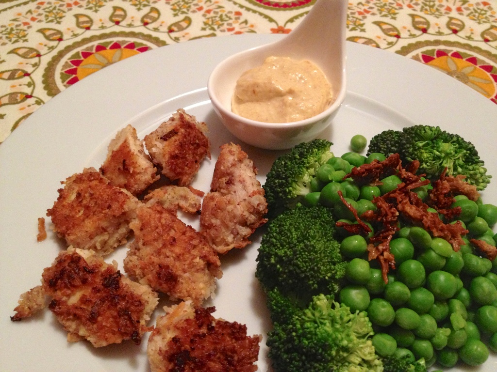 The final result: Coconut chicken nuggets, steamed broccoli & peas, and aioli