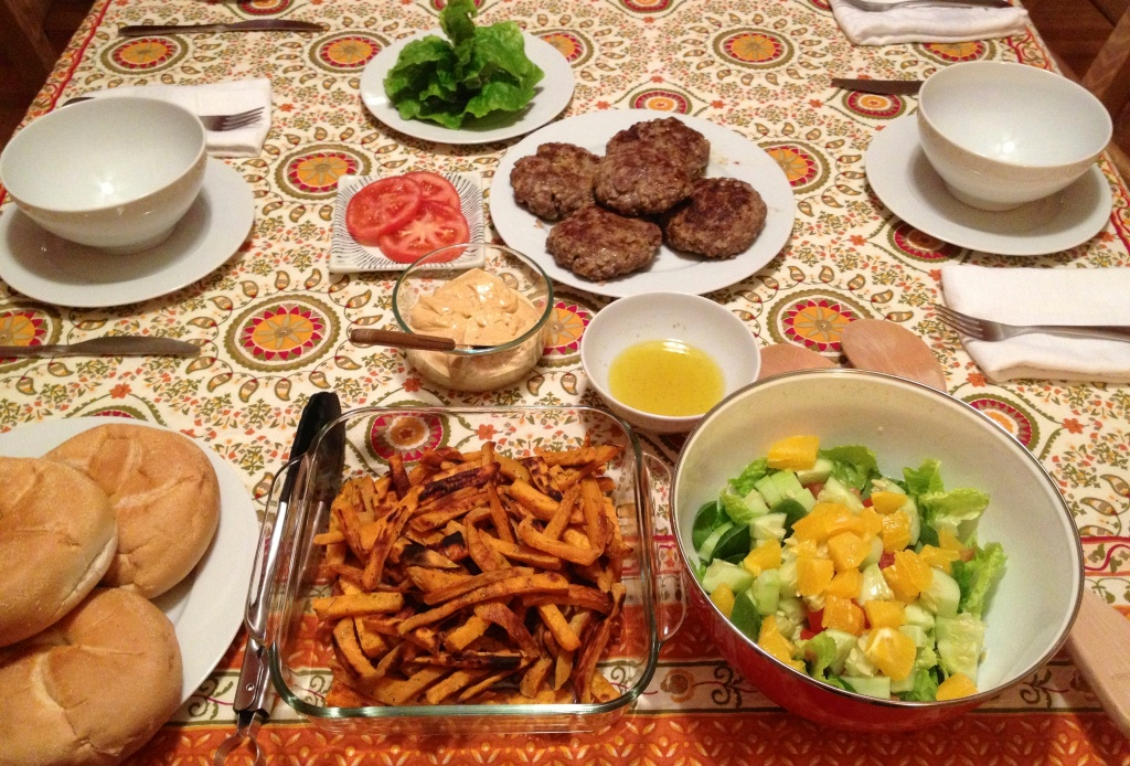Our dinner: burger, toppings, sweet potato fries and a salad.