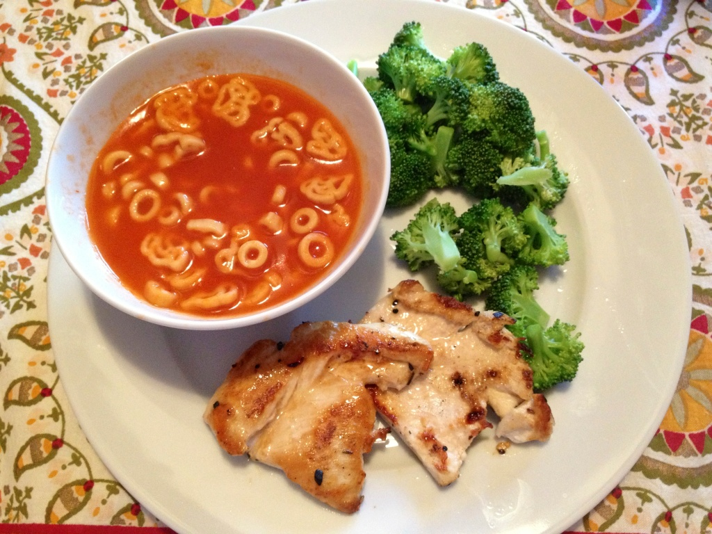 Spaghetti-O's with broccoli and chicken breast.
