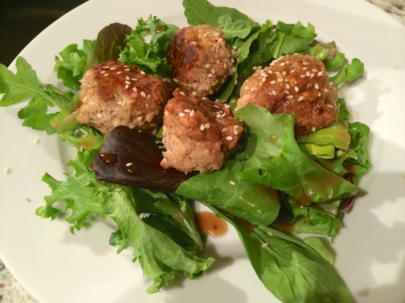 Turkey meatballs on a bed of spring mix, with a sesame ginger vinaigrette.