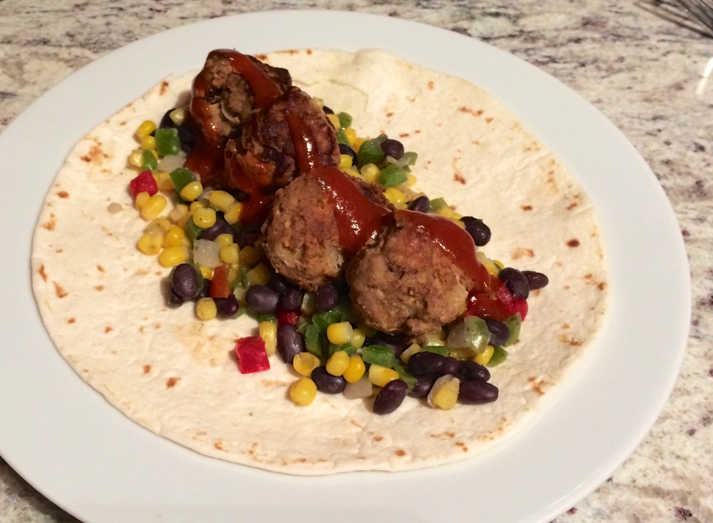 Meatballs and southwest frozen veggies on flour tortilla with Ortega taco sauce