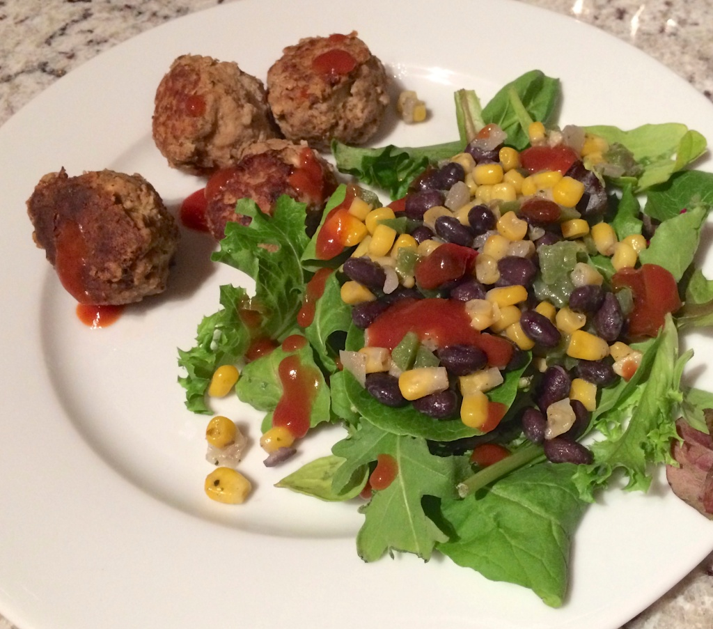 Meatballs with a side salad (spring mix and frozen veggies leftovers), drizzle of Ortega taco sauce